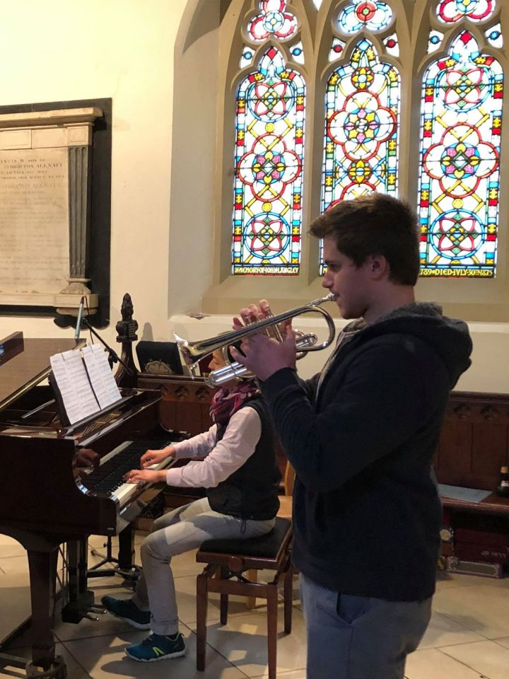Students playing inside the church